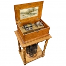 Style B Capital Cuff Musical Box on Cuff Storage Table, c. 1895