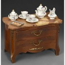 Miniature Marble-Topped Doll's Commode and Porcelain Tea Service