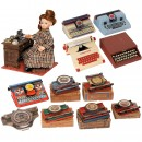 11 Toy Typewriters and an Office Doll